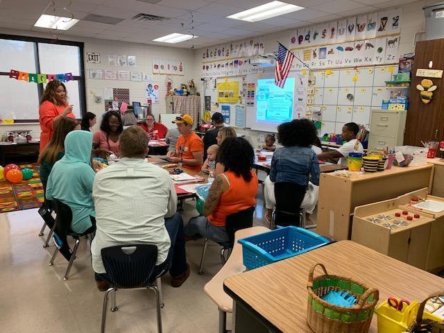 K-1 Teacher discussing APTT with parents