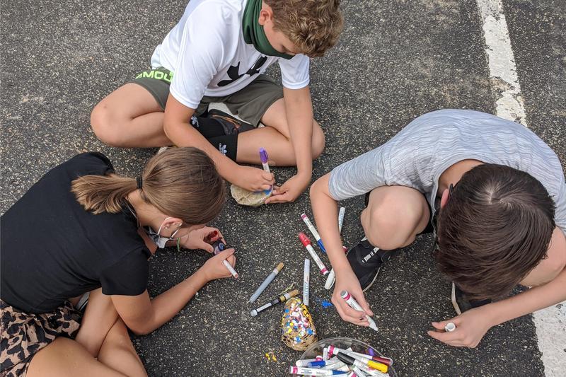 students painting rocks