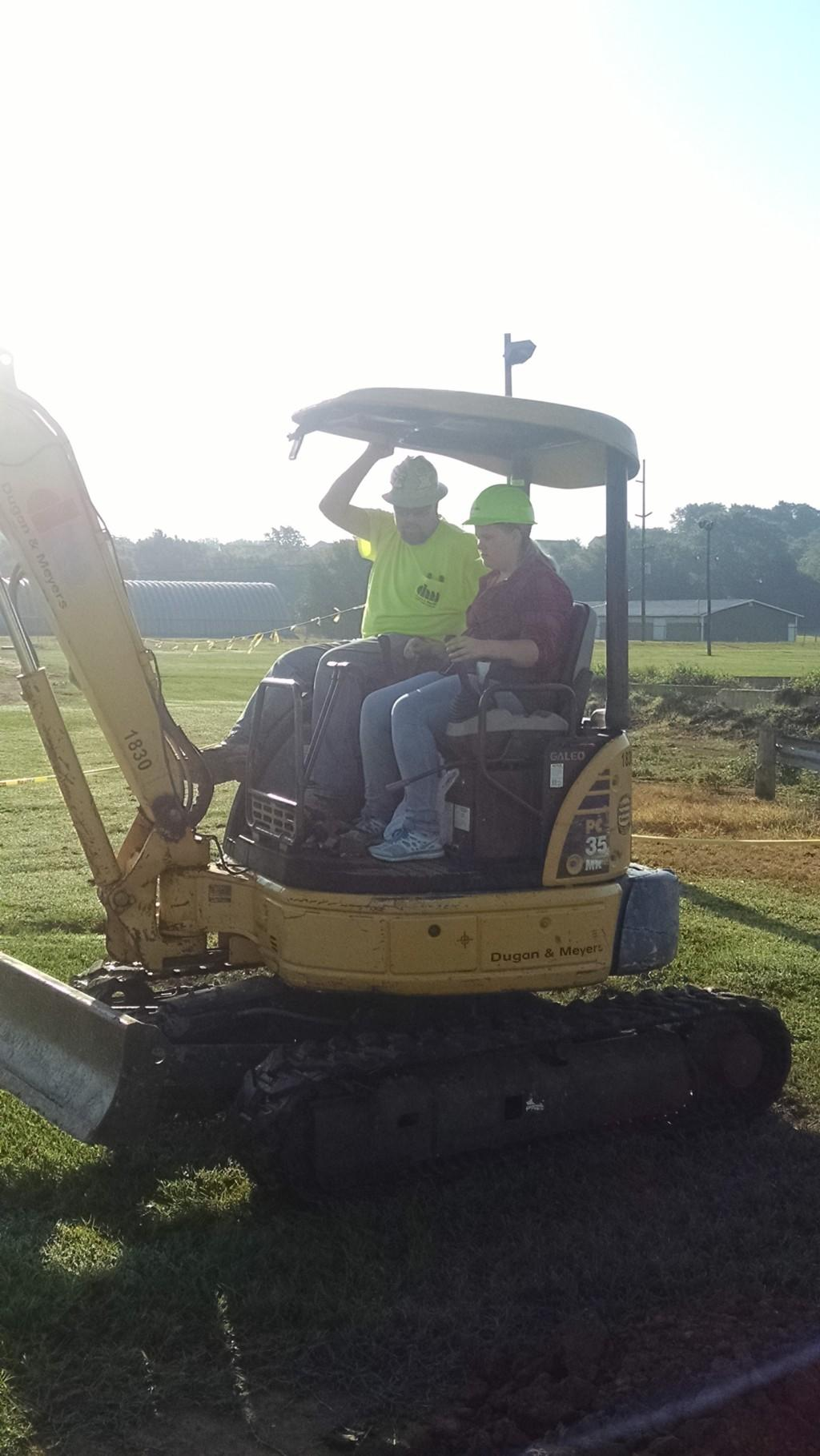 Student operating heavy construction equipment.