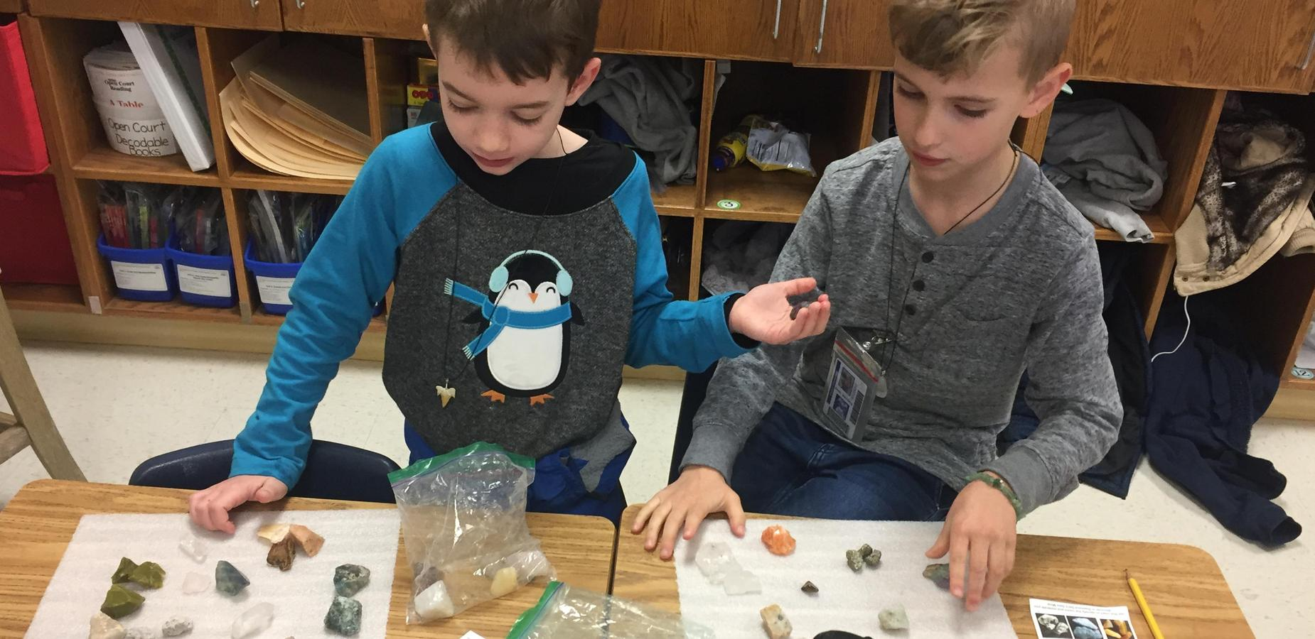 Students doing experiments with rocks