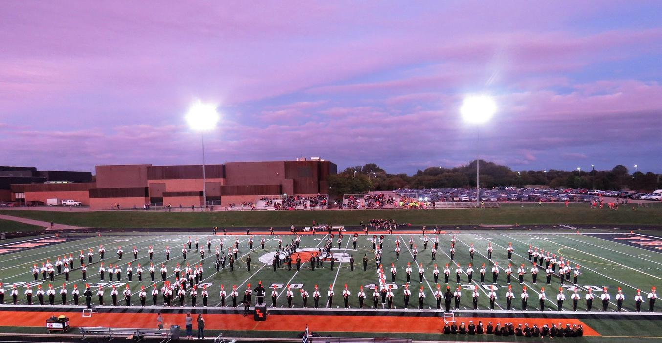 The 197-member TKHS  marching band fills the football field during a halftime performance.