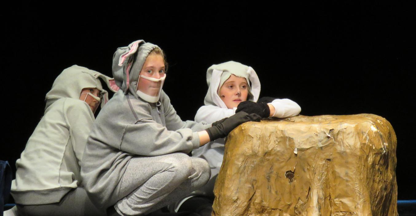 Students portray three sheep in the retelling of