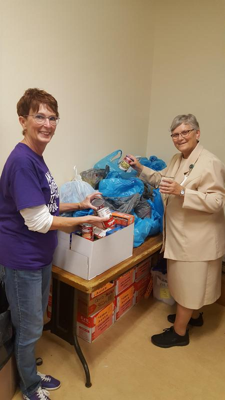photo of OLSH teachers with food pantry collections