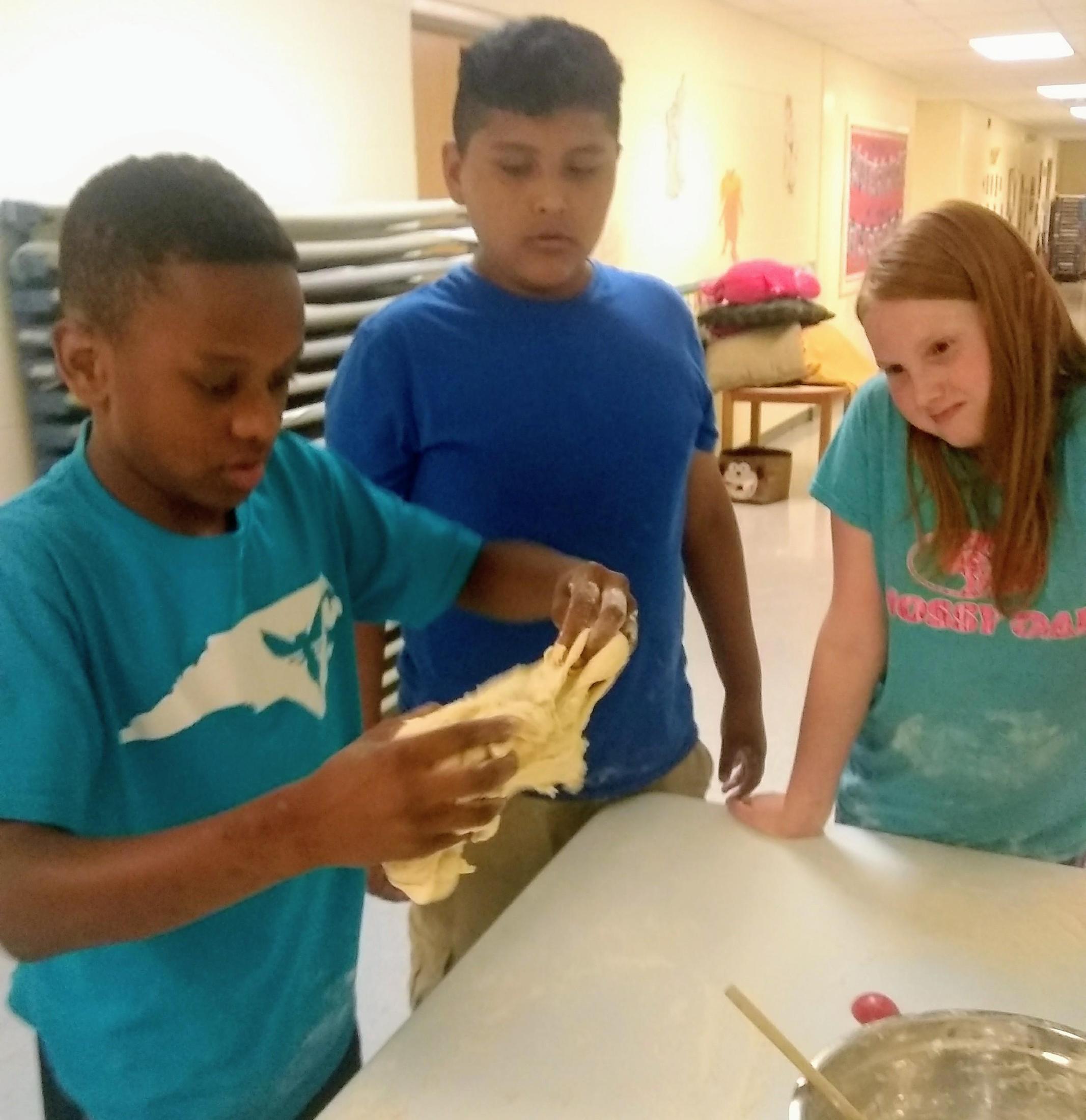 children kneading dough