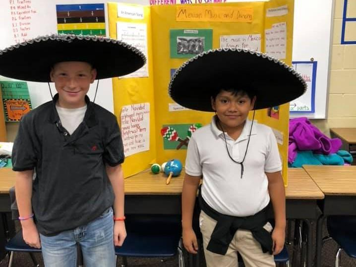 Two 4th grade students in sombreros celebrating Mexico Christmas