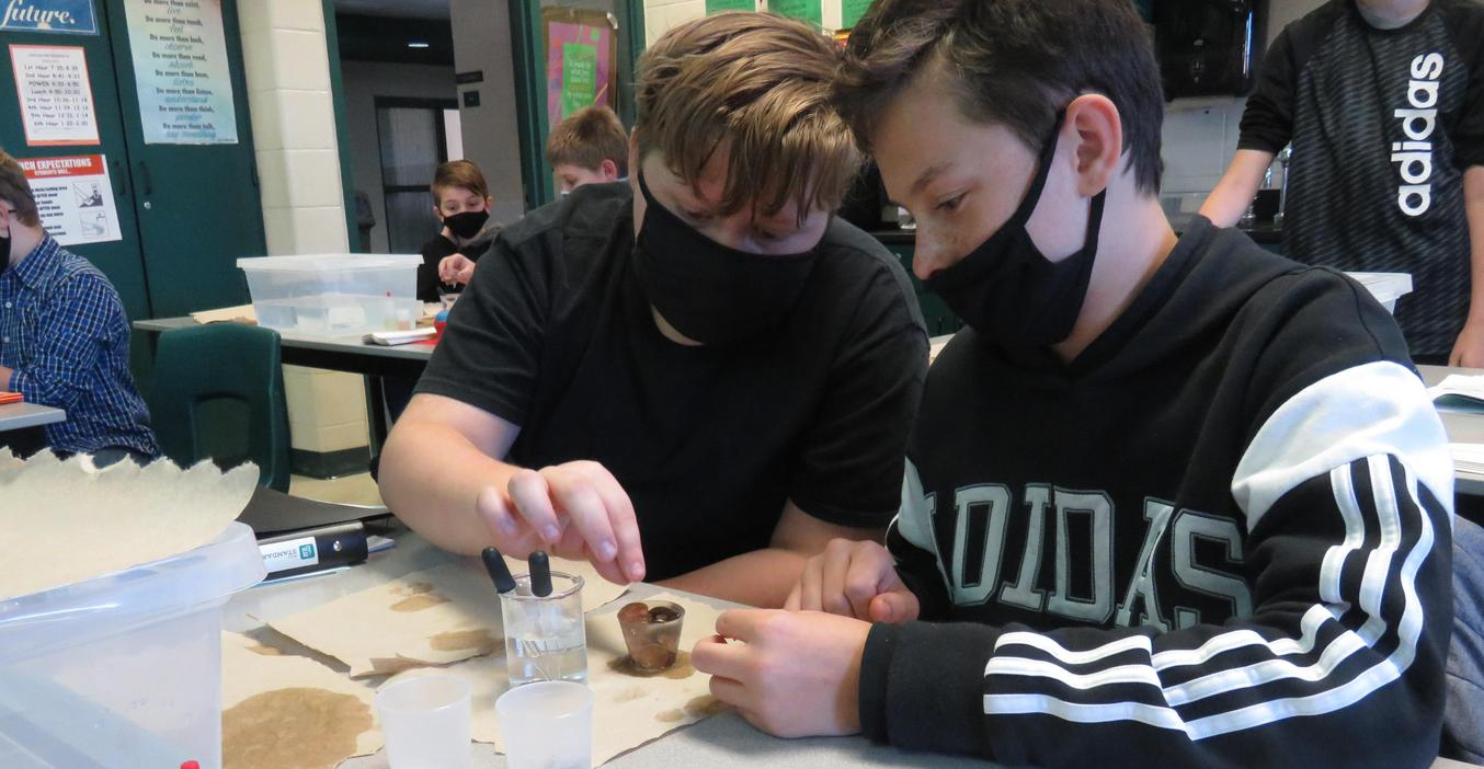 Students conduct an experiment in science class.