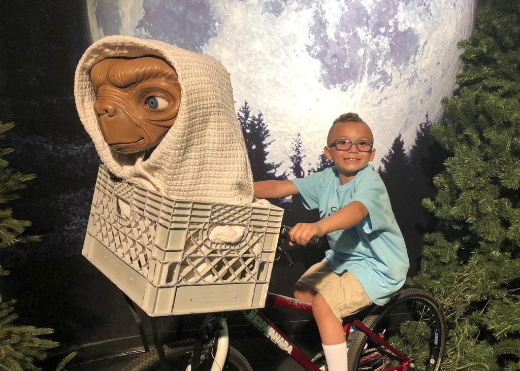 Camper at Wax Museum with ET on bicycle