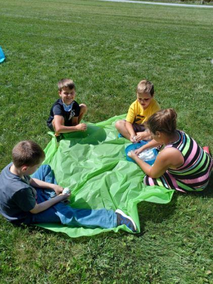 Kids on a blanket