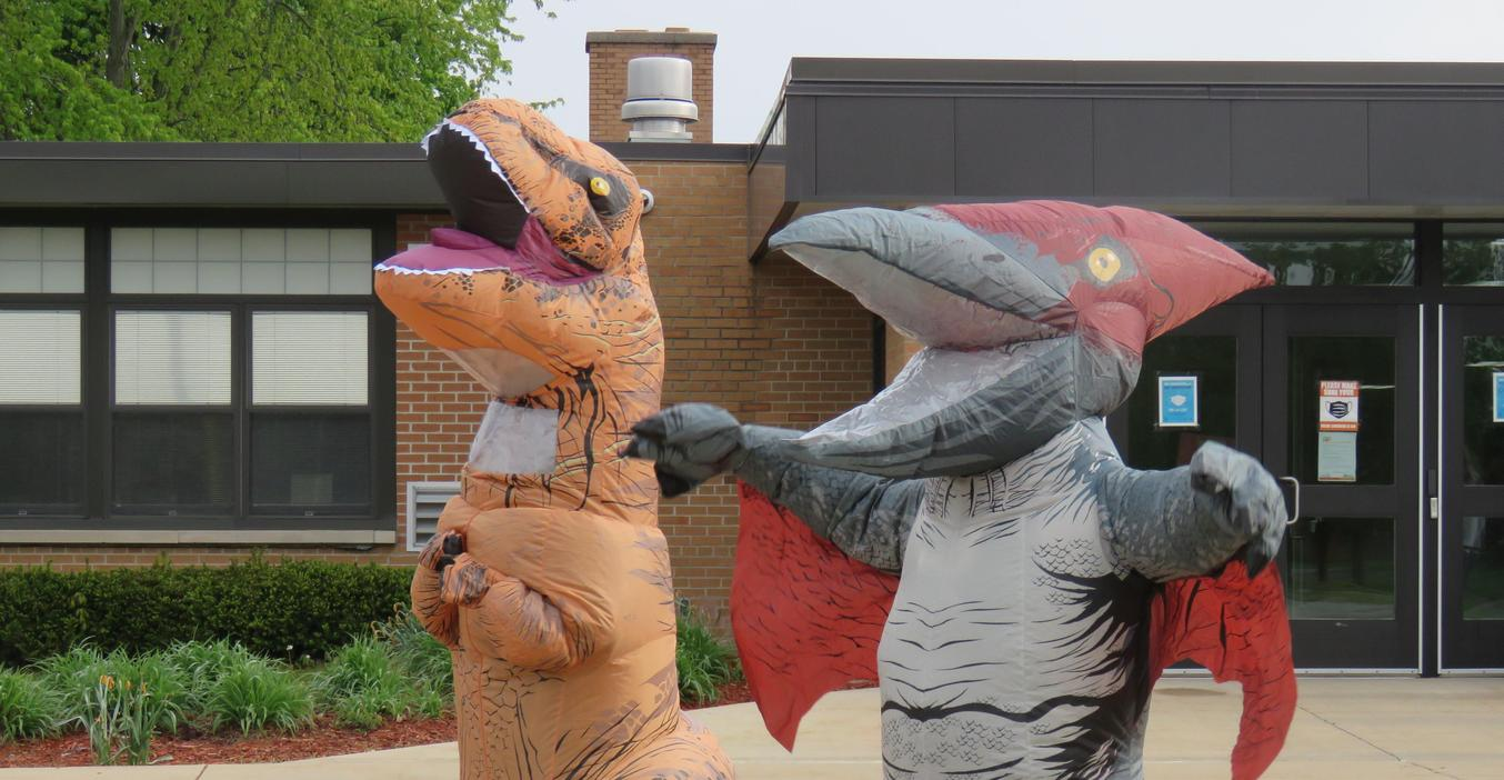 Lee staff dress as dinosaurs to greet students as part of their Friday morning routine.