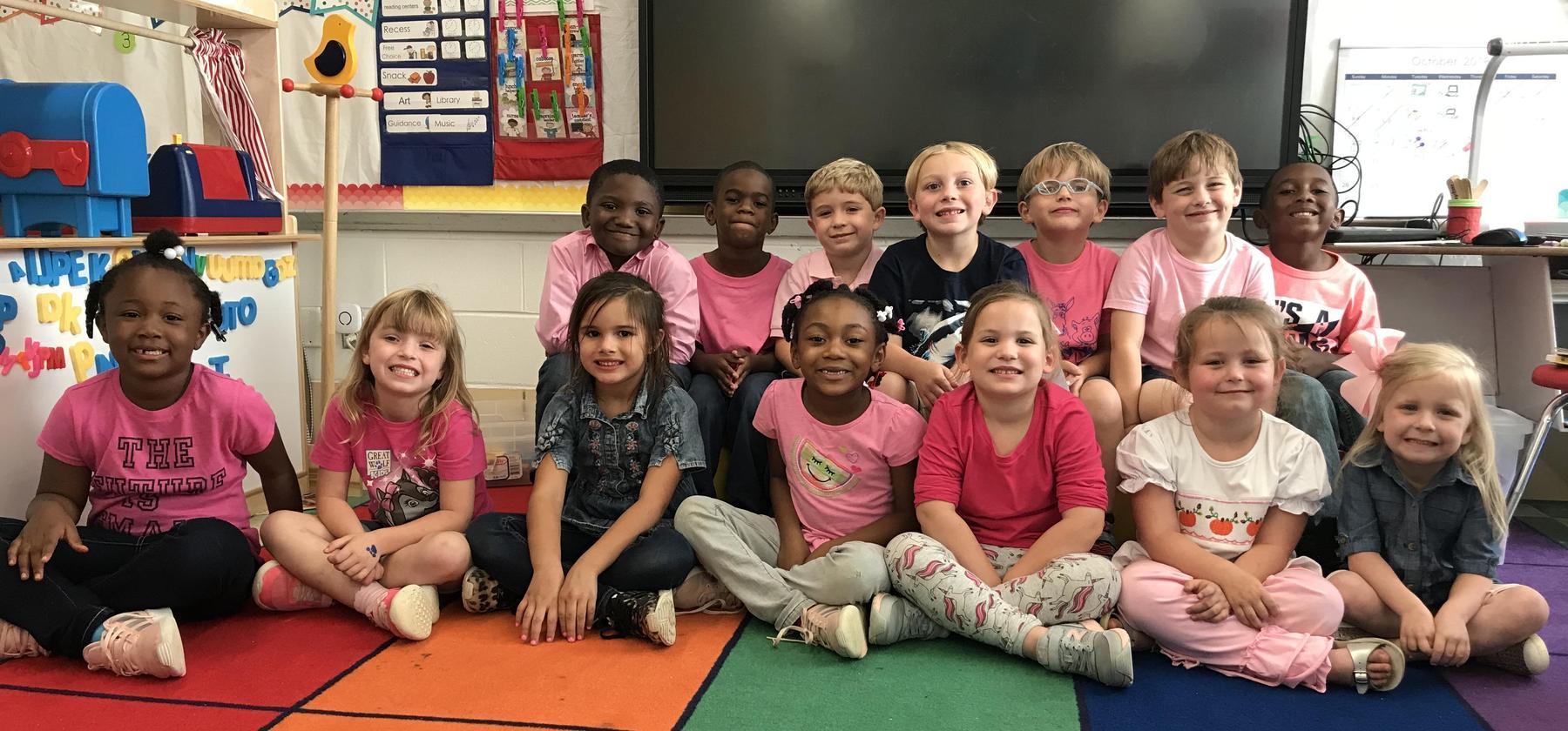 class wearing pink shirts