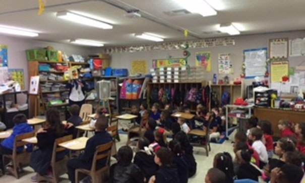 Mrs. Marks reads a bilingual story to the kindergarten classes!