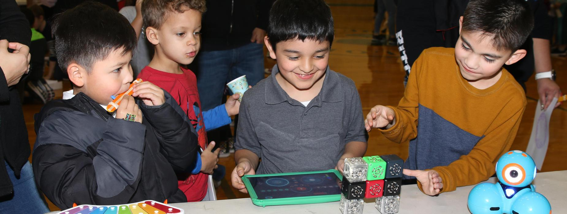 Students playing science games.