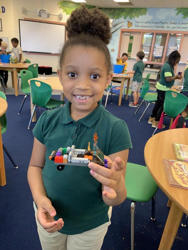 student with Lego vehicle