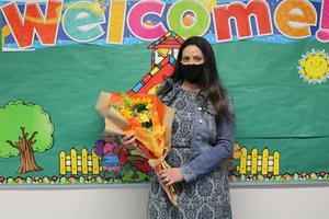 Ms. Tambone holding flower bouquet