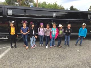 students in line to ride limo lunch