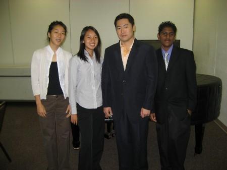 Three students with internship advisor