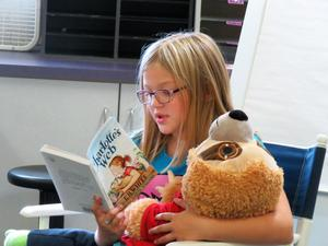 A Lee Elementary student dives into reading her new book.