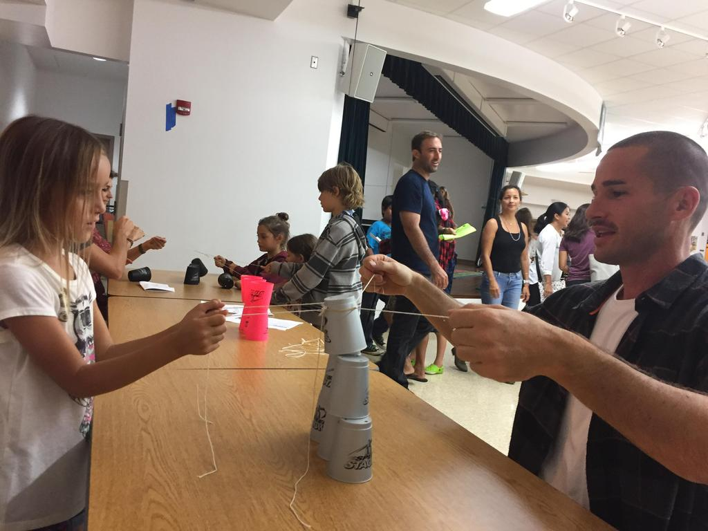 Father and Daughter work on cup challenge.