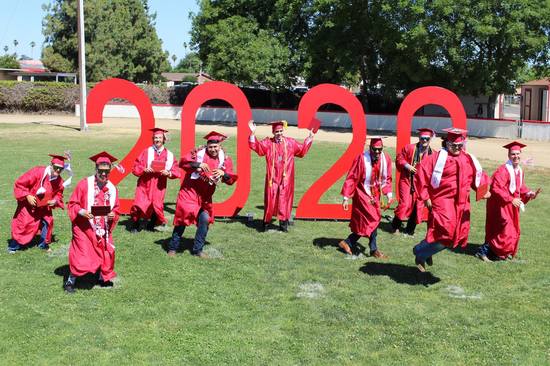 Left to right, Devin Glenn, Roman Diaz, Ryan Basler, Damian Rodriguez, Ali Misleh, Amit Grewal, Westley Roberts, Daniel Nieves, and Tristan Holt turning their tassels