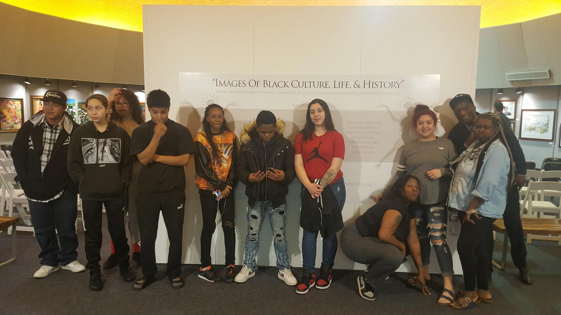 San Bernardino students pose at a museum