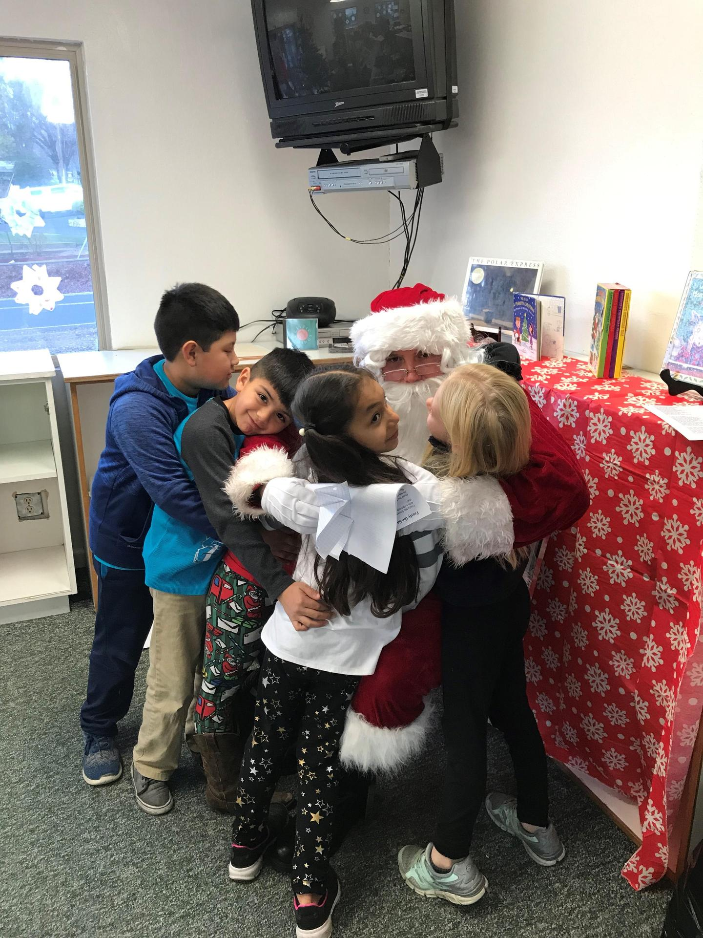 Big hug for santa at michelson 2018