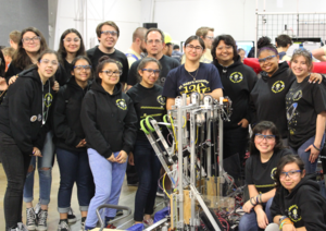 All girls robotics team with robot
