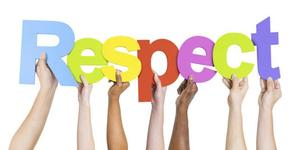 Diverse hands hold up the letters that spell RESPECT