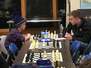 chess team members compete