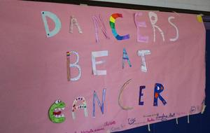 Photo of sign at 8th Annual McKinley-Thon when students and staff dance to raise money for pediatric cancer research.