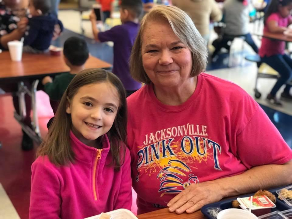 Grandmother and grand daughter during Thanksgiving luncheon