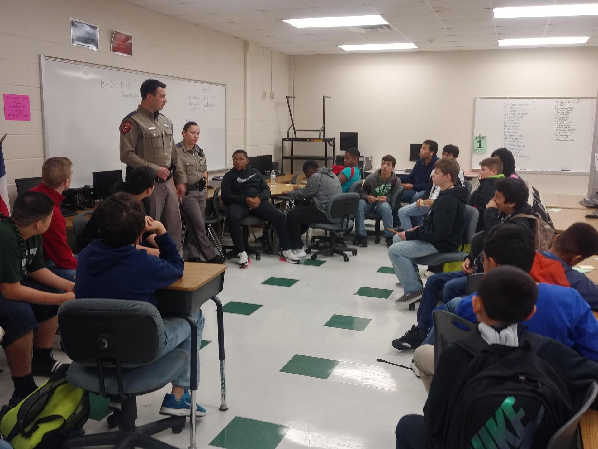 2 officers speaking to class of students at their desks