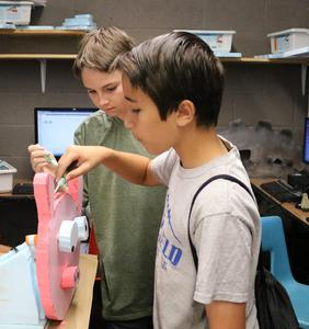 STEM campers build animatronic device during STEM Camp.