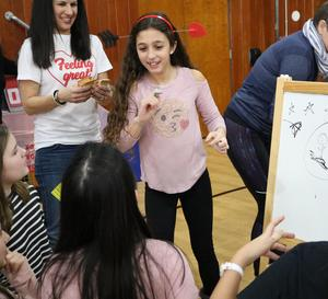 Photo of Tamaques School 5th graders playing a pictionary game during Valentine's Day fun.
