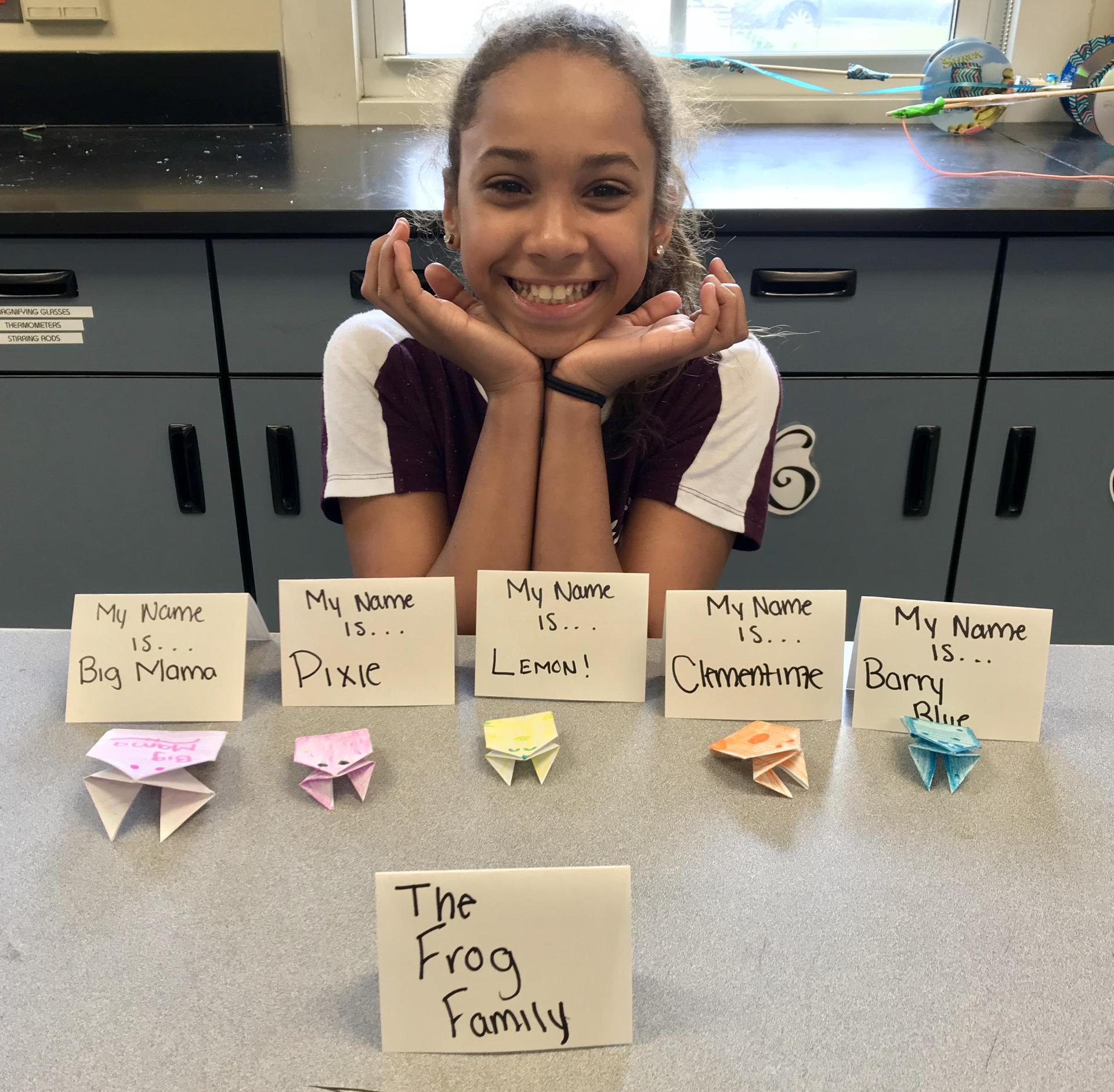 Student with Origami Frogs