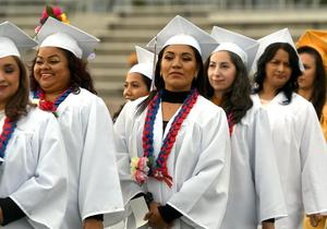 Graduates in Baldwin Park Adult and Community Education's high school equivalency program – clad in white – celebrate their commencement ceremony on May 23 at Baldwin Park High School.