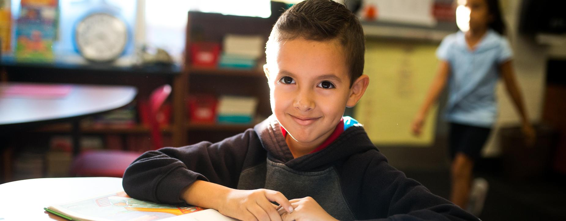 smiling boy at desk