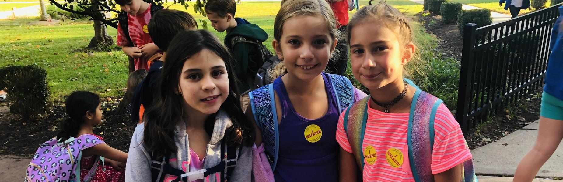 Photo of three McKinley students on Walk to School Day.