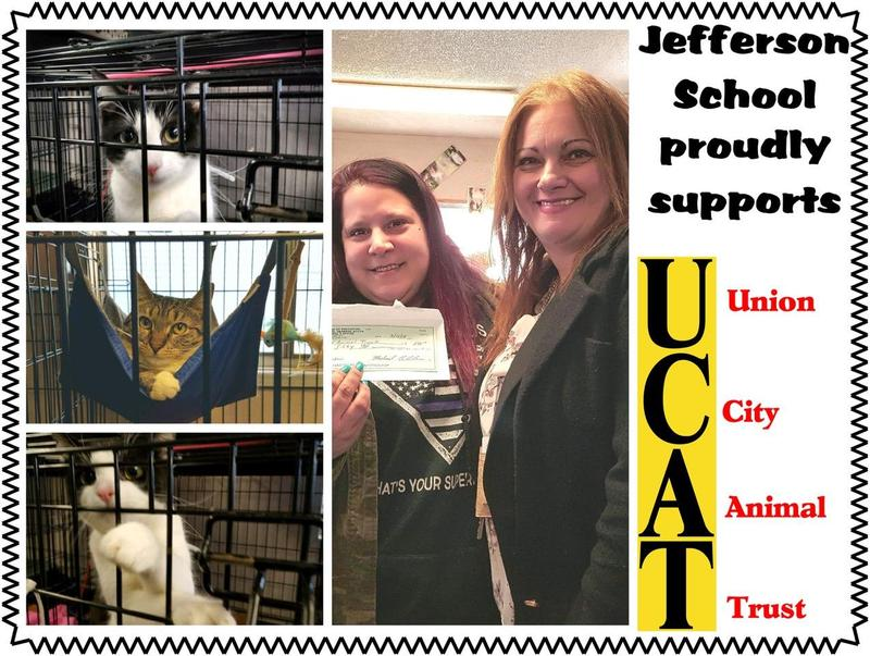 Jefferson school representative handing check to UCAT representative