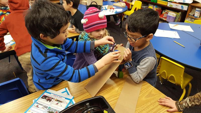 Kindergarten students creating slopes with blocks