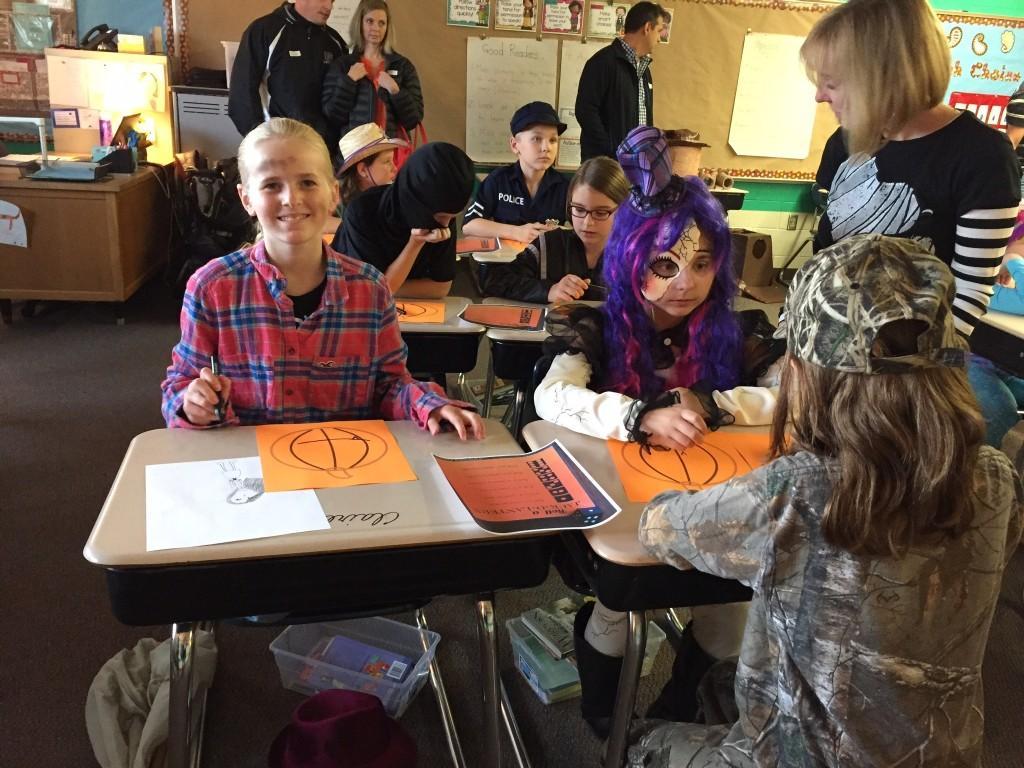 kids making pumpkin crafts