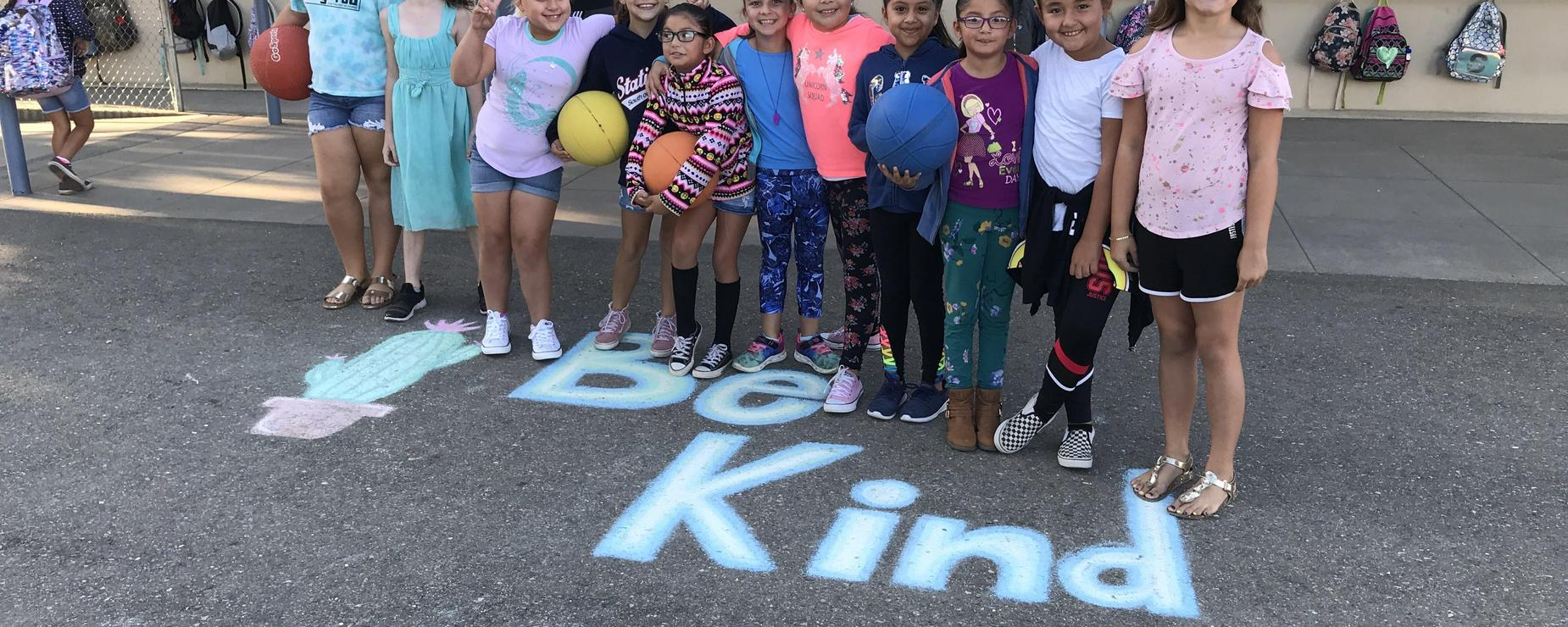 Be Kind sidewalk chalk and kids
