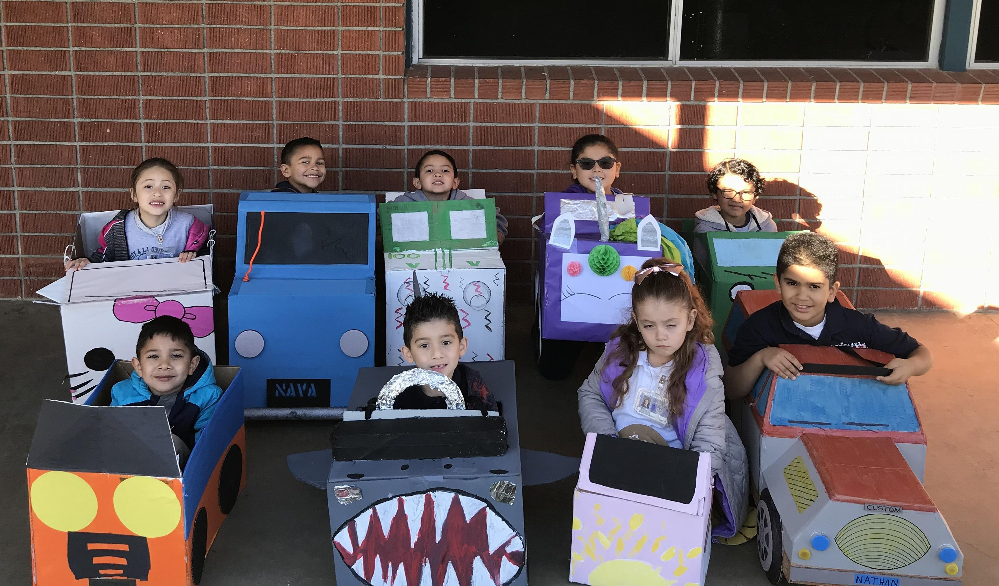 Students posing with their Box Cars