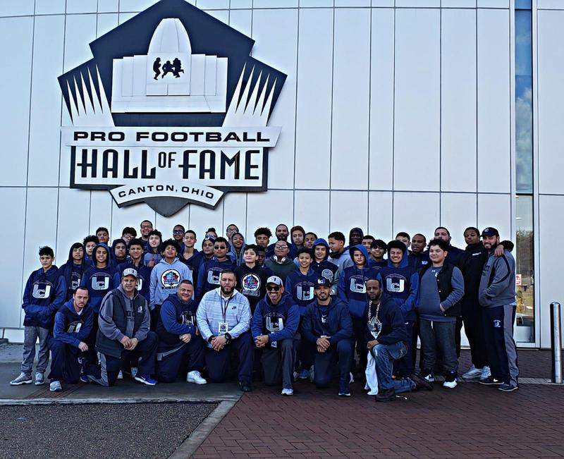 youth football team in front of the hall of fame museum building