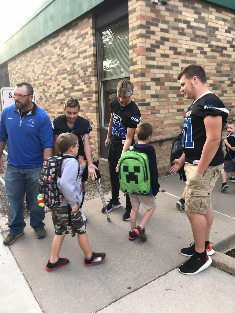 HS Football players greet elementary students