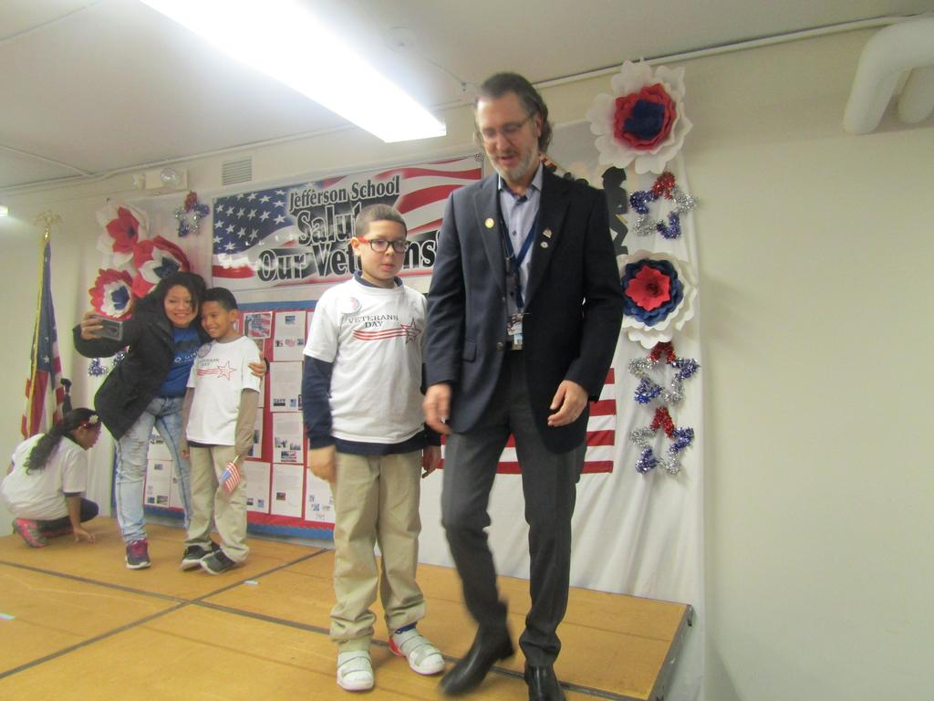 boy and dr. williams getting off the stage