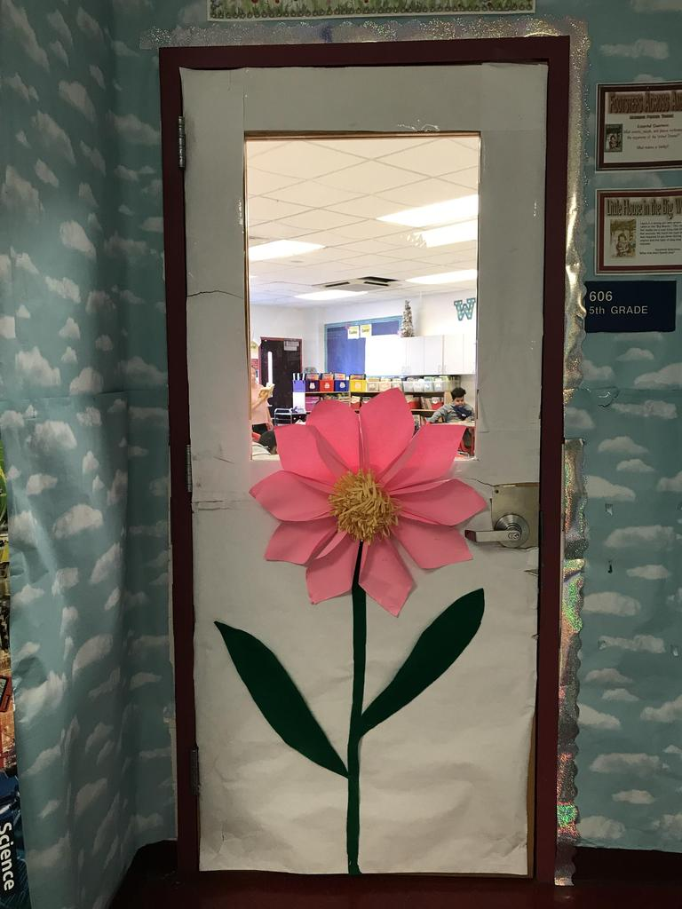 606 5th grade door with a large pink paper flower