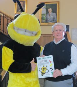 Mayor W.T. Daniels and Benny The Bee pose with