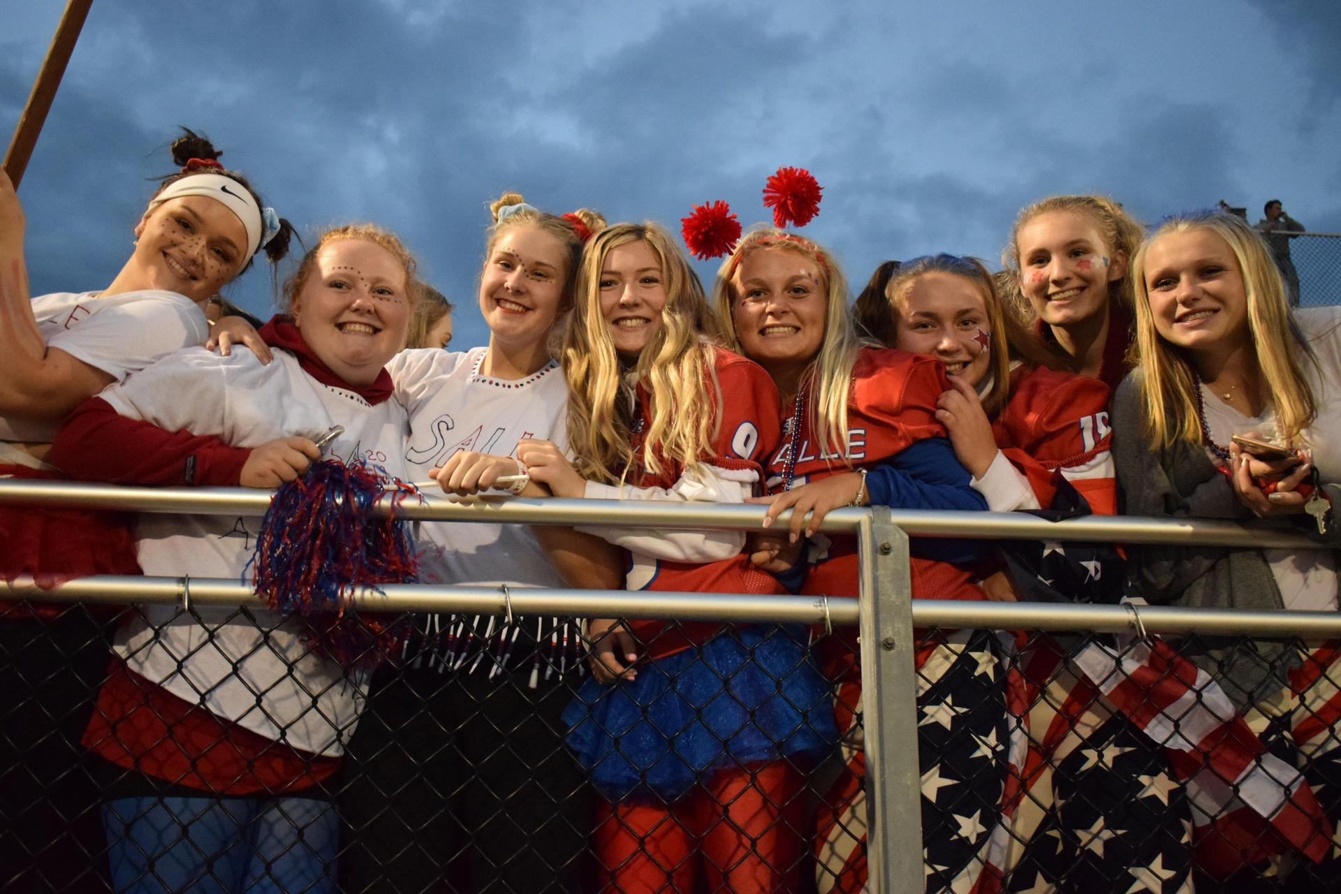 students in the stands at a football game