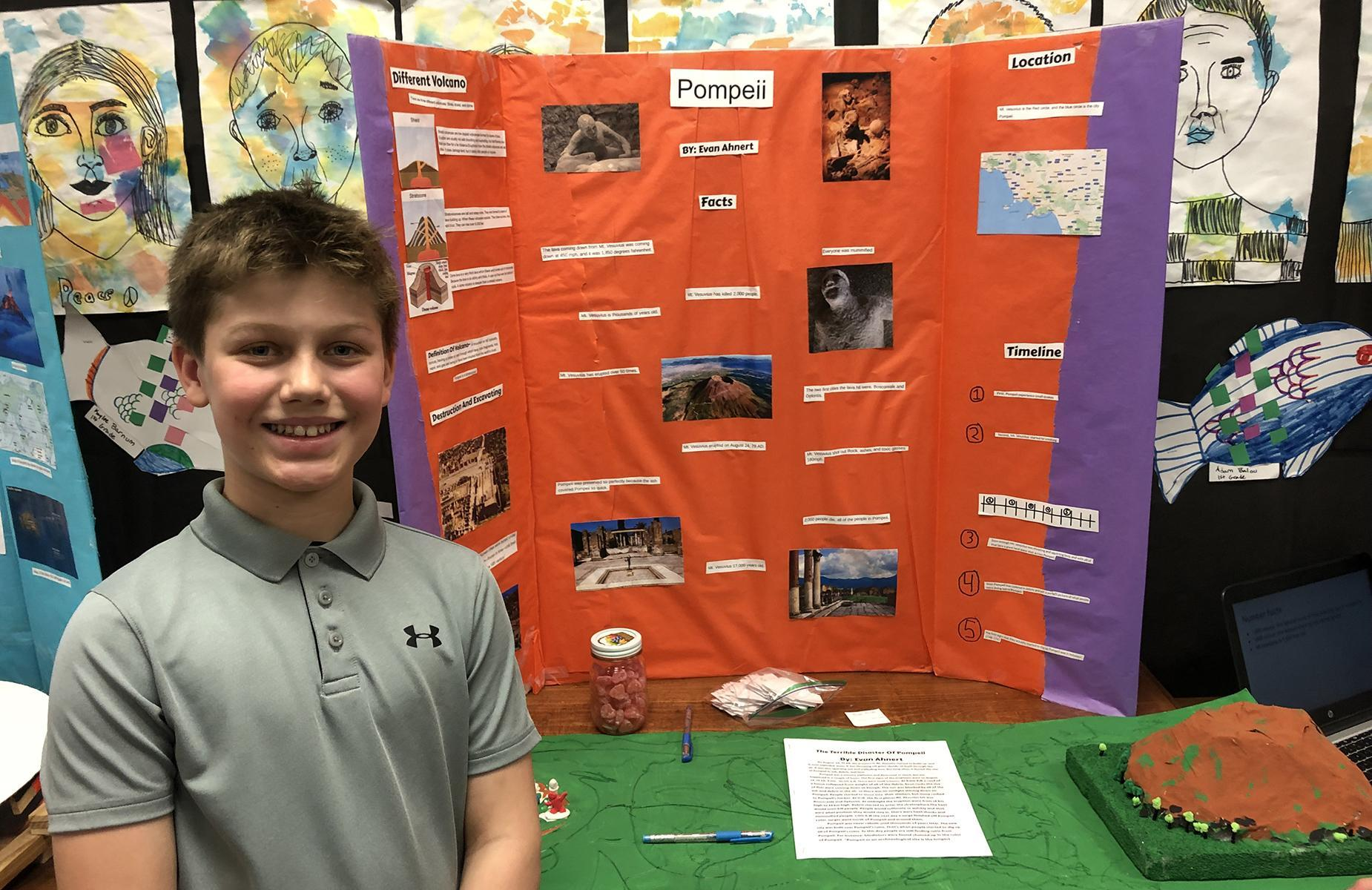 student showing his display on Pompeii