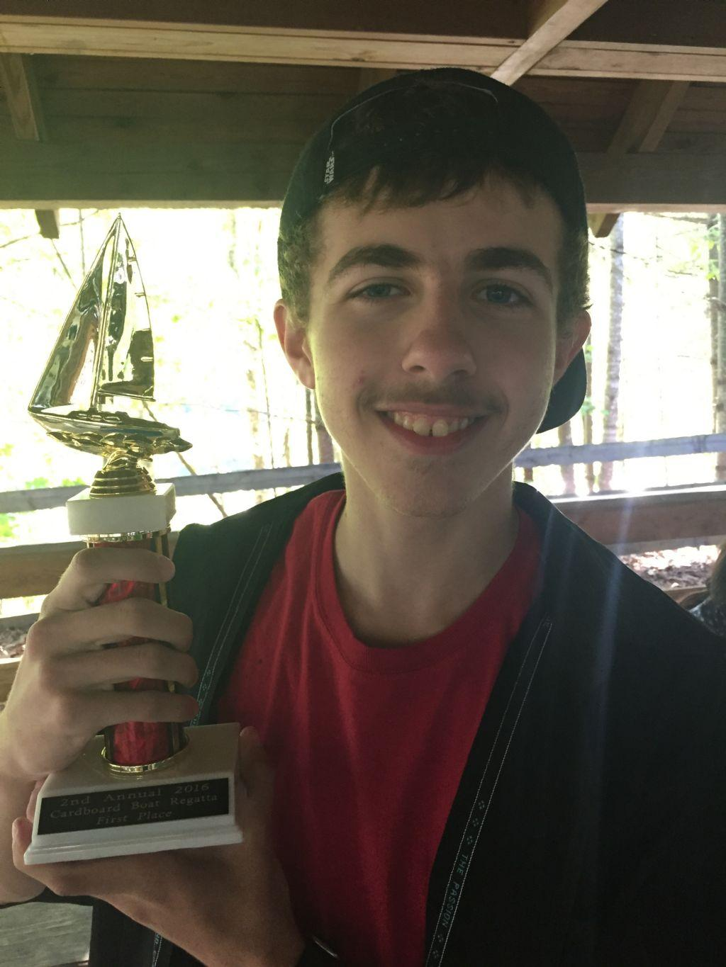 student with trophy